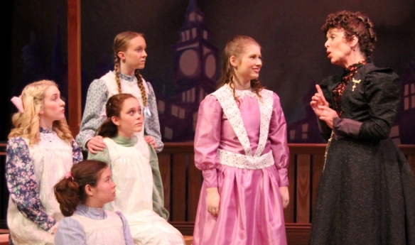 "Sara (Alyssa Middleton), Miss Minchin (Deborah Tranelli) and the Girls in Sacramento Theatre Company's ""A Little Princess."" Photo by Kelly Christoffersen."